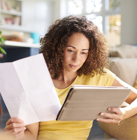 Woman reading insurance papers